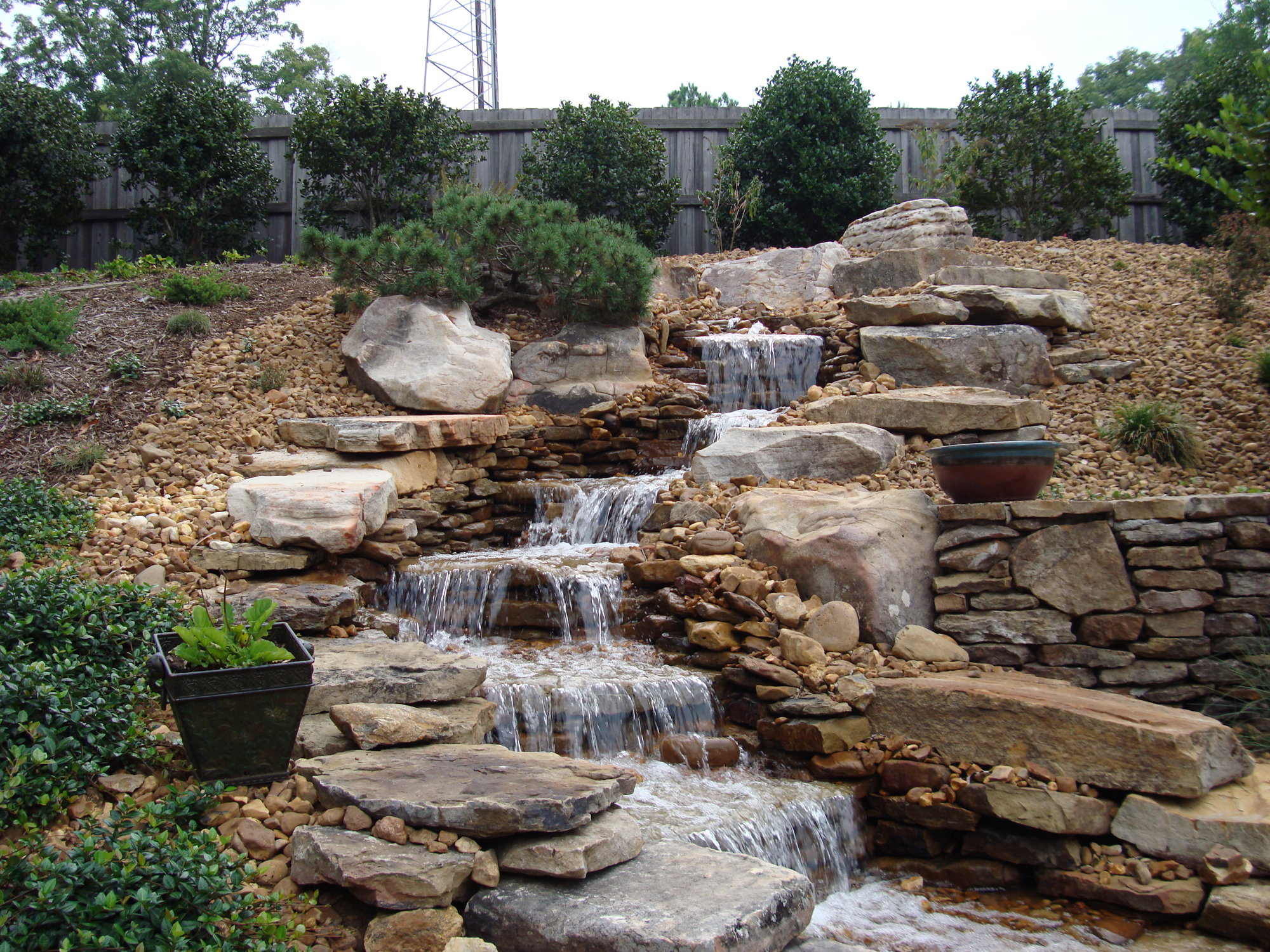 Pondless waterfalls a beautiful alternative to ponds for Stone garden waterfall